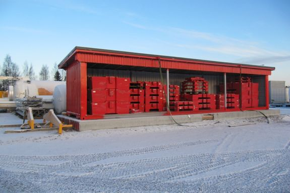 Red warehouse with weigh lifting euipment